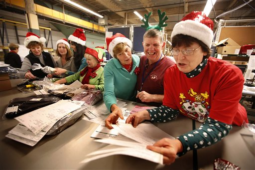 LL Bean employees wear Santa Claus hats and antlers as they celebrate the holiday spirit while working in the company's order fulfillment center onThursday in Freeport. The outdoors store is making its final push to get things shipped in time for Christmas.