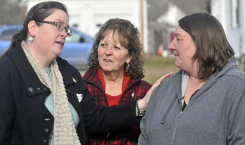 Laurie Ann Robbins, left, and Christine Belangia, center, comfort Terri Foulkes, right, daughter of murder victim Rita St. Peter, outside the Somerset County Superior Court House in Skowhegan, after the sentencing of Jay Mercier for the 1980 murder of Rita St. Peter on Friday. Belangia was St. Peter's sister; Robbins was a friend.