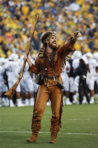 West Virginia University Mountaineer mascot Jonathan Kimble rallies fans during a game between WVU and University of Maryland in Morgantown, W.Va.