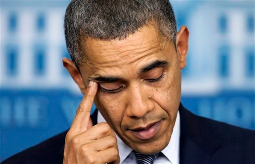 President Barack Obama wipes his eye as he talks about the Connecticut elementary school shooting, Friday, Dec. 14, 2012, in the White House briefing room in Washington. (AP Photo/Carolyn Kaster)