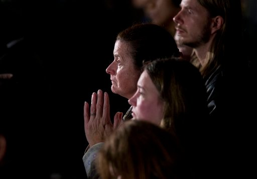 Mourners at Sunday's interfaith vigil.