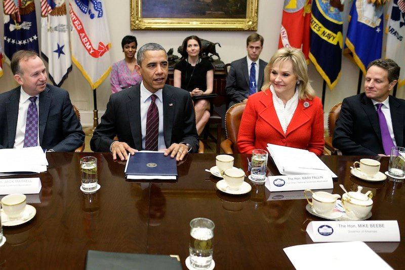 President Barack Obama, flanked by National Governors Association (NGA) Chairman, Delaware Gov. Jack Markell, left, and NGA Vice Chair, Oklahoma Gov. Mary Fallin, meets with the NGA executive committee regarding the fiscal cliff, Tuesday, Dec. 4, 2012, in the Roosevelt Room at the White House in Washington. Treasury Secretary Tim Geithner is at right. (AP Photo/Charles Dharapak)