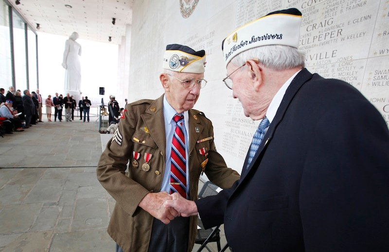 Pearl Harbor survivors Max Green, left, and Bill Thornton greet each other prior to the Pearl Harbor Day Remembrance Ceremony at the Va. War Memorial, in Richmond, Va. on Friday, Dec. 7, 2012. The ceremony remembers those Virginians who died during the Japanese attack on Pearl Harbor, Hawaii on December 7, 1941. (AP Photo/Richmond Times-Dispatch, Dean Hoffmeyer)