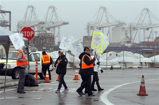 Striking workers man the picket line at the Port of Long Beach last Friday in Long Beach, Calif.