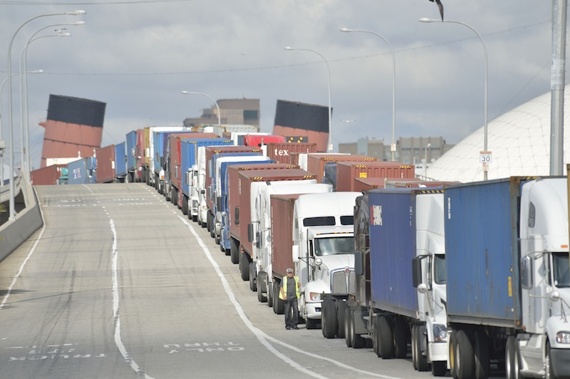 Trucks line up on Pier J Avenue. as they wait to get in to Cosco, one of the few terminals open during the clerical workers strike, in the Port of Long Beach, Calif., on Monday, Dec. 3, 2012. Negotiators returned to the bargaining table Monday as a strike that has crippled operations at the nation's largest port complex entered its seventh day. (AP Photo/The Daily Breeze, Jeff Gritchen)