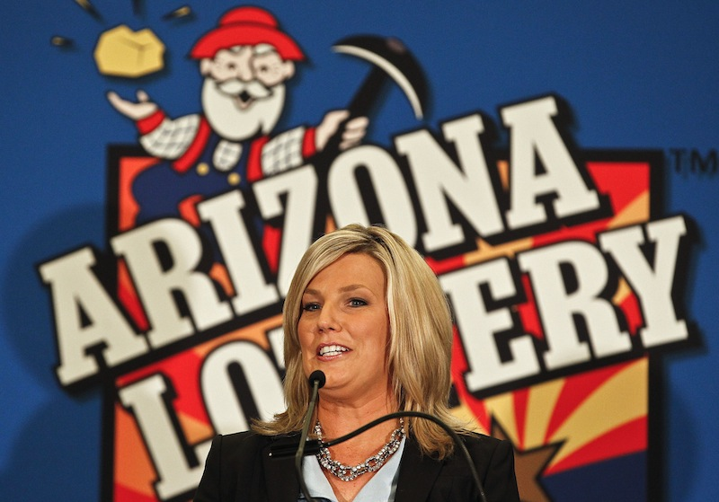 In this Nov. 29, 2012 photo, Karen Bach, Director of Budget, Products and Communications of the Arizona Lottery, announces during a news conference in Phoenix that one of the winning tickets in the $579.9 million Powerball jackpot was purchased in Fountain Hills, Ariz. The other ticket holders in last week's record $577.5 million Powerball jackpot have claimed their half of the prize but aren't stepping into the spotlight just yet, the Arizona Lottery said Friday, Dec. 7, 2012. (AP Photo/Ross D. Franklin, File)