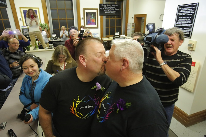 Steve Bridges, left, and Michael Snell, both of Portland, kiss after being the first couple to be married at Portland City Hall on Saturday morning, December 29, 2012.