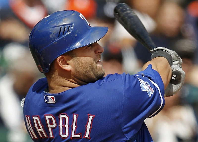 In this April 21, 2012, file photo, Texas Rangers' Mike Napoli hits a solo home run against the Detroit Tigers in the ninth inning of a baseball game in Detroit. A person familiar with the negotiations says Napoli and the Boston Red Sox agreed to a $39 million, three-year contract Monday, Dec. 3. (AP Photo/Paul Sancya, File)