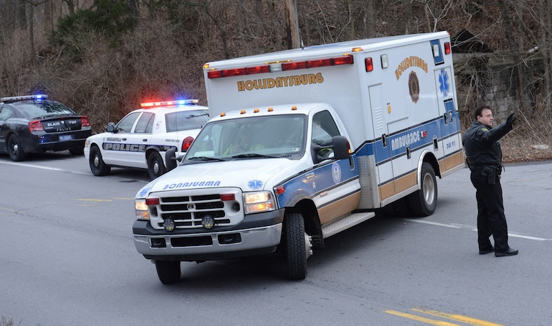 An ambulance from the Hollidaysburg American Legion Ambulance Servie leaves a shooting scene along Rt. 22 near the entrance to Canoe Creek State Park. Geeseytown Shootings