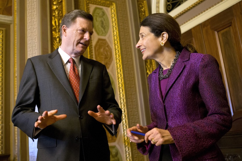 Snowe and McKernan chat after the senator gave her farewell speech in the Senate chamber Thursday.