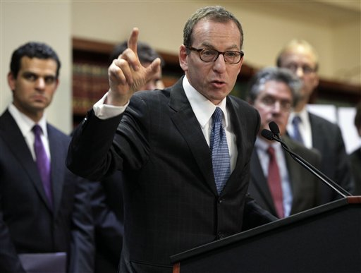 Lanny Breuer, center, assistant attorney general of the Justice Department's Criminal Division, addresses a news conference in on Dec. 11, 2012, to announce British bank HSBC agreed to pay $1.9 billion to settle money-laundering charges.