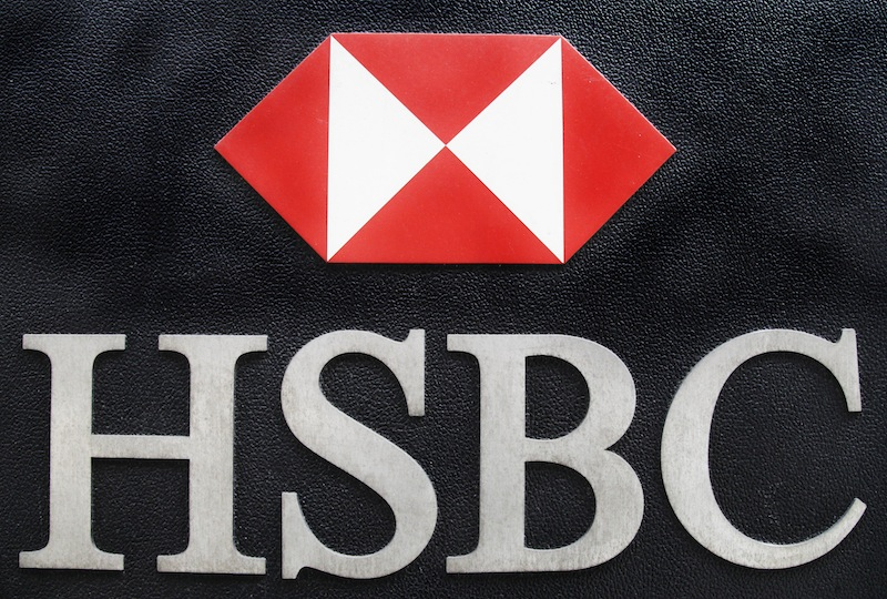 This May 11, 2012, file photo shows the corporate logo for HSBC hangs on a wall outside an office for the London-based multinational bank in New York. When the Justice Department announced its record $1.9 billion settlement against British bank HSBC last week, prosecutors called it a powerful blow to a dysfunctional institution accused of laundering money for Iran, Libya and Mexico's murderous drug cartels. But to some former federal prosecutors, it was only the latest case of the government stopping short of bringing criminal money laundering charges against a big bank or its executives. (AP Photo/Mark Lennihan, File)