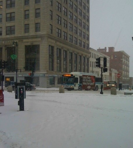 Traffic was light on Congress Street in Portland Thursday as heavy snow and sleet fell in the city.