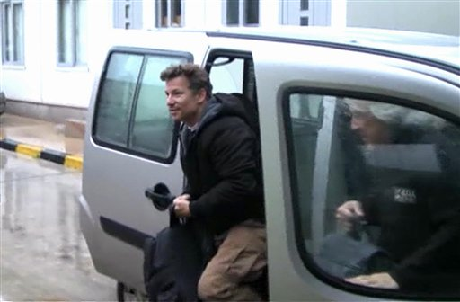 In this image from video, NBC chief foreign correspondent Richard Engel exits a car in Turkey after he and his television crew were freed unharmed following a firefight at a Syrian checkpoint.