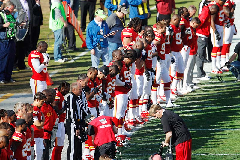 Kansas City Chiefs players stand for a moment of silence before the start of Sunday's game against the Carolina Panthers at Arrowhead Stadium in Kansas City, Mo. The Chiefs had a moment of silence for all victims of domestic abuse before the national anthem on Sunday.