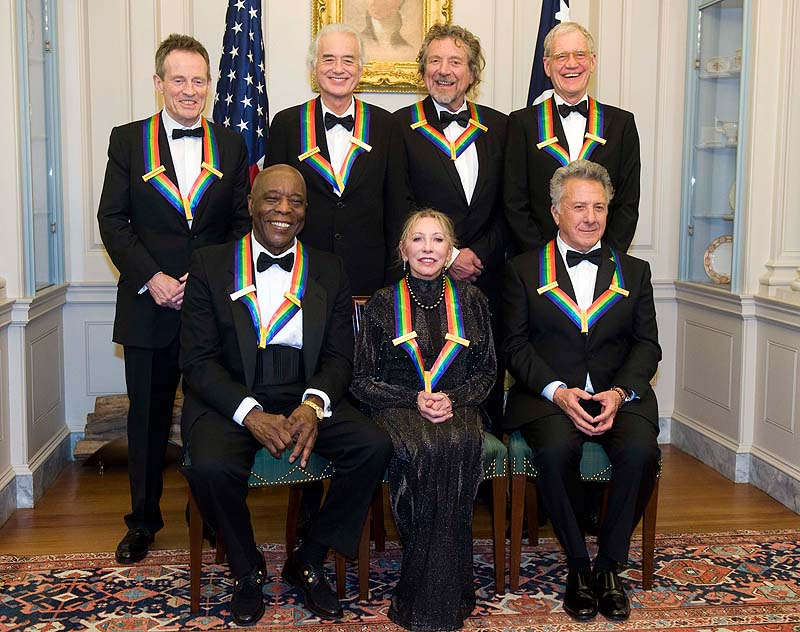 The 2012 Kennedy Center Honorees, from left, John Paul Jones, Buddy Guy, Jimmy Page, Natalia Makarova, Robert Plant, Dustin Hoffman, and David Letterman pose for a group photo after the State Department Dinner for the Kennedy Center Honors gala Saturday at the State Department in Washington.