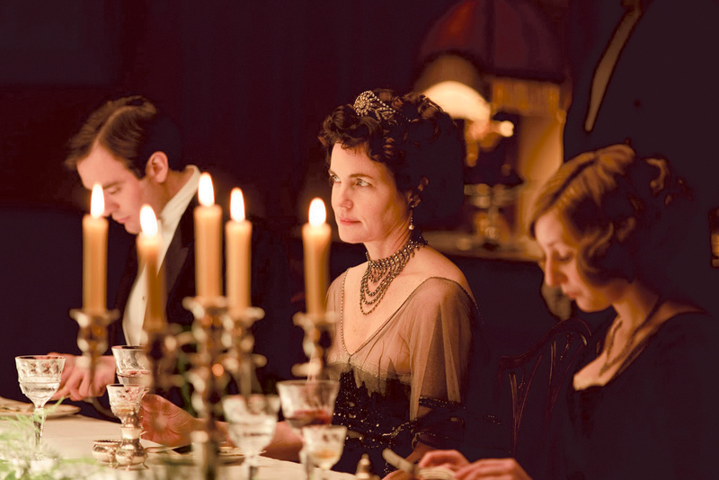 "Elizabeth McGovern (center), who plays Cora Crawley, in an elegant upstairs dining scene from ""Downton Abbey."""