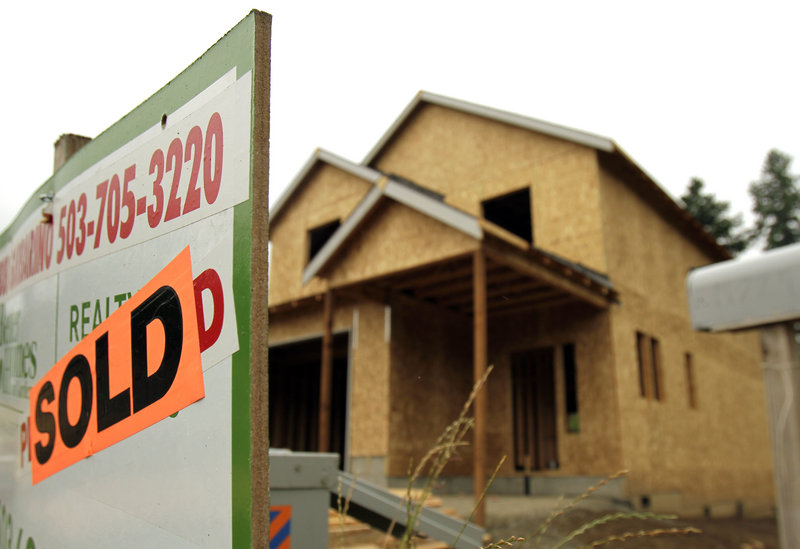 A single-family home under construction in Portland, Ore., boasts a sold sign in July. Lawrence Yun, chief economist at the National Association of Realtors, said that now would be the worst possible time to change the mortgage interest deduction because it would further depress demand in the struggling housing sector.