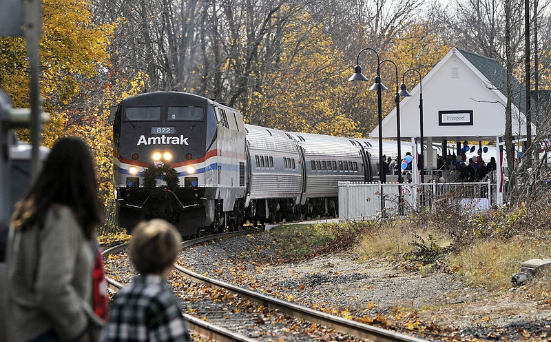 In this November 2012 file photo, the Amtrak Downeaster sits at Freeport Station, after a special ceremony, awaiting departure for Brunswick Station on its Inaugural run for service from Boston to Freeport and all stops between. Nearly twice as many people as projected rode Amtrak Downeaster's new line to Freeport and Brunswick during its first month of passenger service, the Northern New England Passenger Rail Authority says.