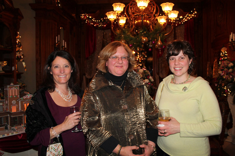 From Dodge the Florist, which created the dining room decorations, are Robin Turnbull, Gail Diamon, the owner, and Shannon Hanley.