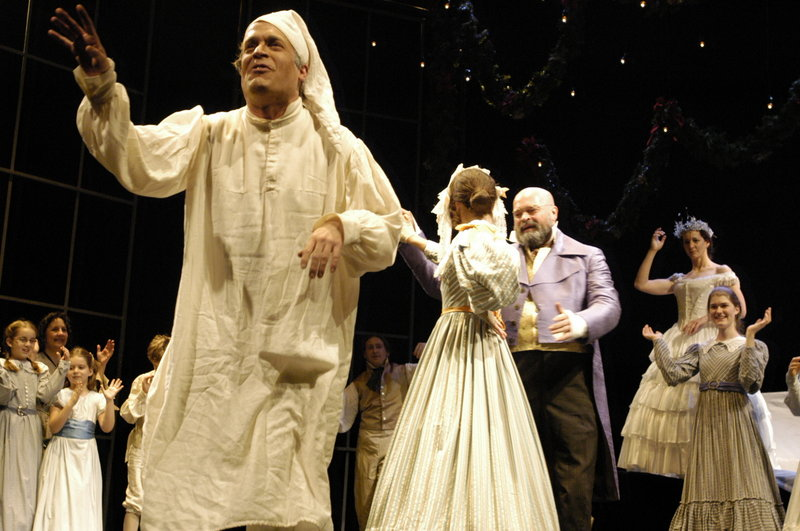 """Scrooge (Tom Ford) recounts a party at Fezziwig's that he attended as a young man, in the Portland Stage Company production of Dickens' """"A Christmas Carol,"""" continuing through Dec. 23."""