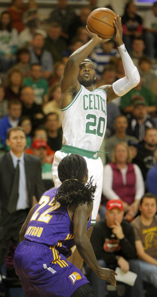 Shelvin Mack of the Maine Red Claws – who wore Boston Celtics uniforms for the game – shoots over Los Angeles defender Courtney Fortson in a 97-94 loss at Portland on Friday night.