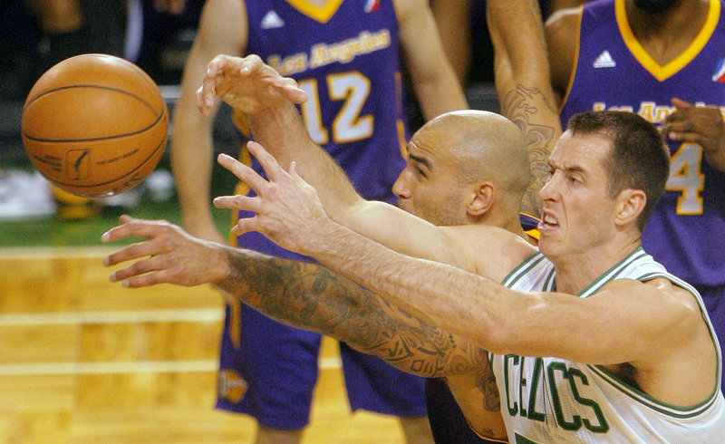 Maine's Chris Ayers, right, battles Robert Sacre of the D-Fenders for a loose ball during Friday nights 97-94 loss to Los Angeles. The Red Claws fell to 2-1 on the year.