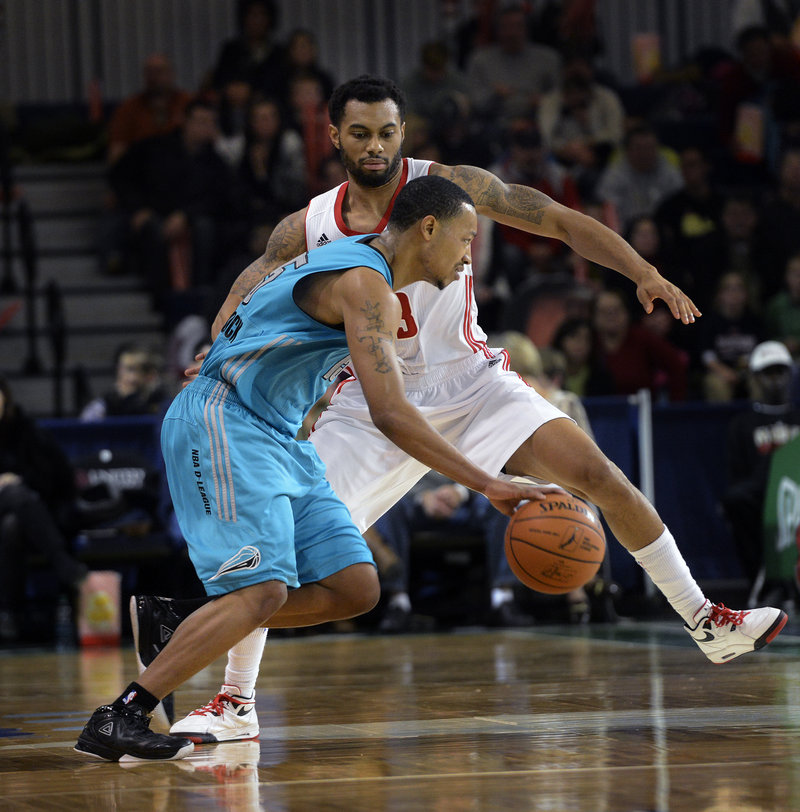 Xavier Silas of the Red Claws plays defense against Sioux Falls' Andrew Goudelock, who scored 24 points for the visiting Skyforce during their 98-87 victory Sunday afternoon at the Expo.