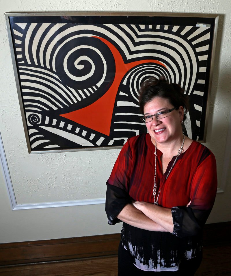 Karen Mallet stands in front of the Alexander Calder print she bought for $12.34 at a Goodwill thrift store in Milwaukee. It turned out to be worth $9,000.