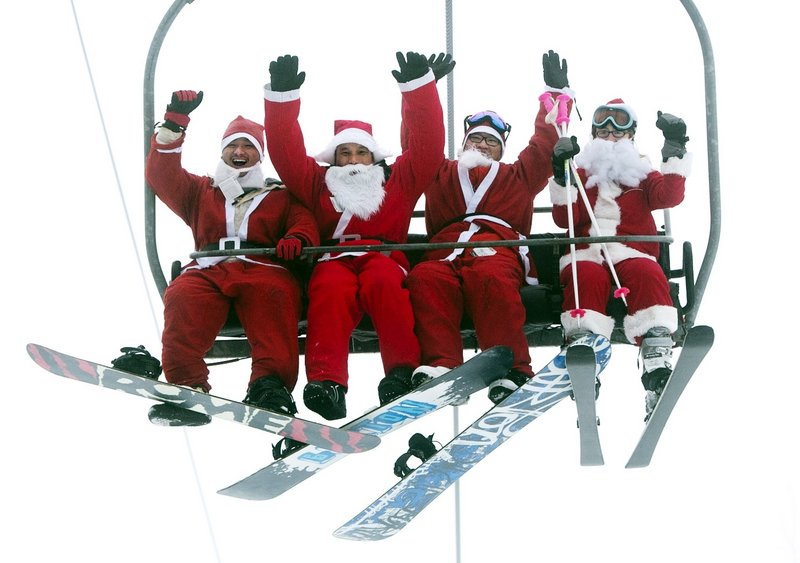 Four Santas ride a chairlift at the Sunday River Ski Resort in Newry on Sunday. More than 250 skiers and snowboarders participated in the annual Santa Sunday event to raise money to benefit the Bethel Rotary Club's Christmas for Children program.