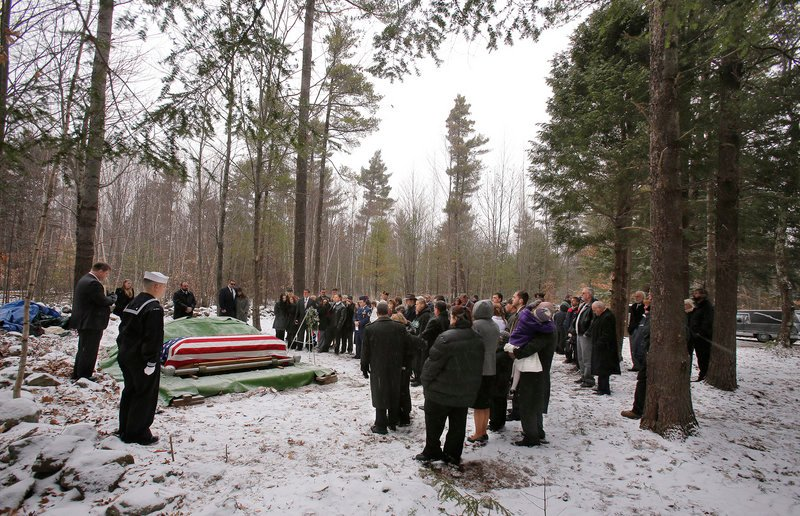 Pastor Mark Kraines, left, leads a burial service for Edward Lovely on Saturday, Dec. 1, 2012. Lovely was buried on the property of his son Don after being diagnosed with lung cancer in October and expressing his desire to be buried on Don's property.