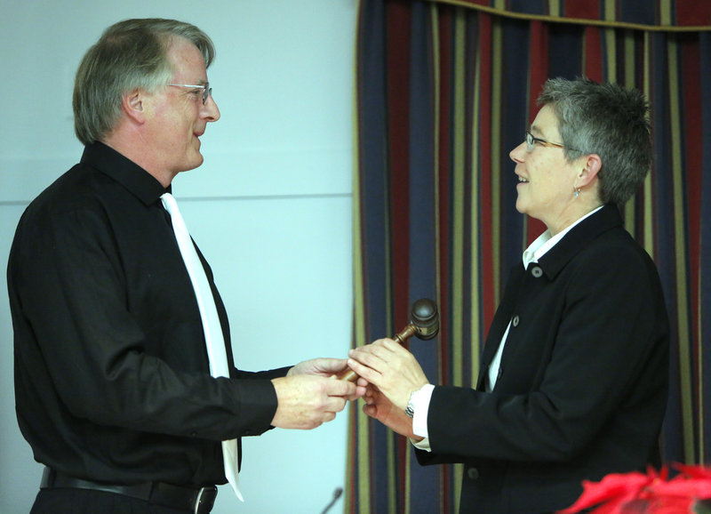 New Mayor Tom Blake presents the outgoing mayor, Patti Smith, with a gavel on Monday in South Portland.