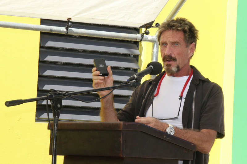 "John McAfee, identified as a ""person of interest"" in the killing of his neighbor, speaks last month during a presentation at the San Pedro Police Station in Ambergris Caye, Belize."