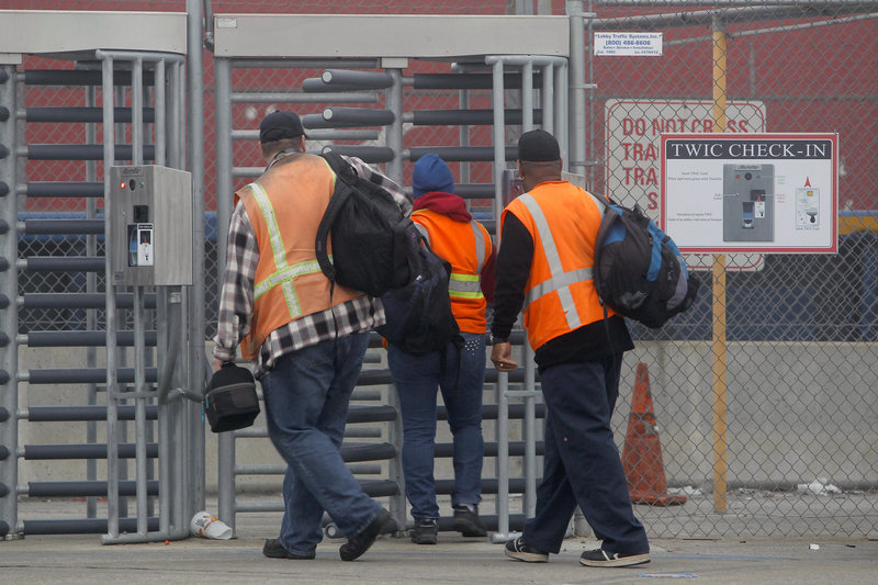 Workers returned Wednesday to the ports in Long Beach and Los Angeles, after settlement of a strike that had crippled the container port complex for eight days.