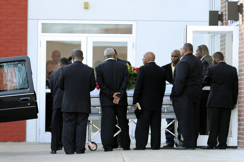 A coffin with the body of Chiefs linebacker Jovan Belcher is placed in a hearse after a service at the Landmark International Deliverance and Worship Center Wednesday in Kansas City, Mo.