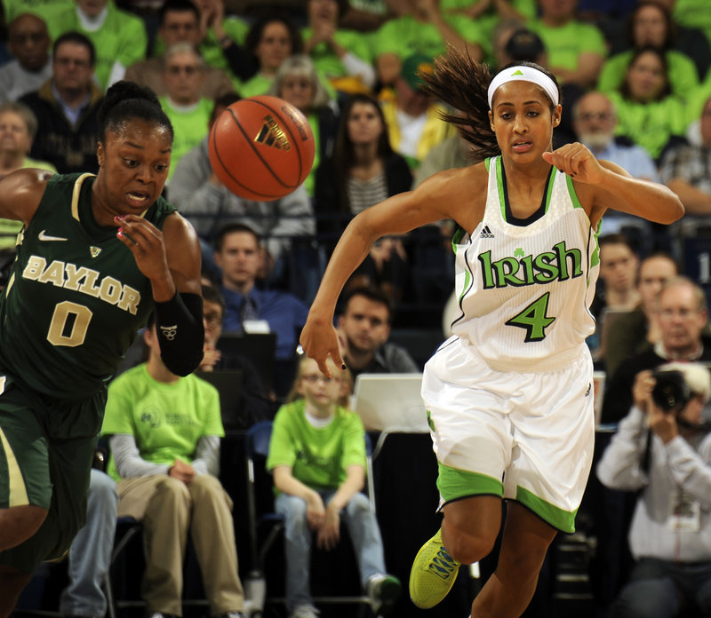 Odyssey Sims, left, of Baylor and Notre Dame's Skylar Diggins chase a loose ball in Wednesday's big matchup in South Bend, Ind. No. 3 Baylor beat No. 5 Notre Dame, 73-61.