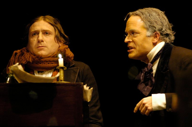 "Mark Honan, left, stars as Bob Cratchit and Tom Ford is Scrooge in Portland Stage Company's ""A Christmas Carol."""