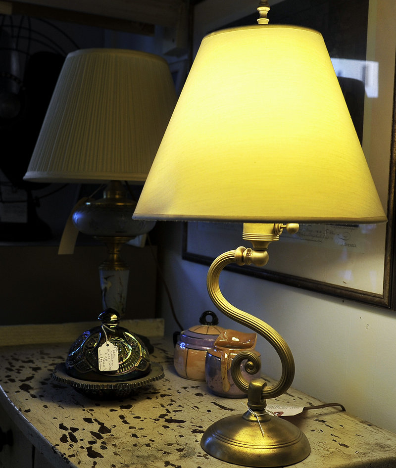 Allen also creates lamps from odds and ends, including a table lamp, left, made from an old chandelier.