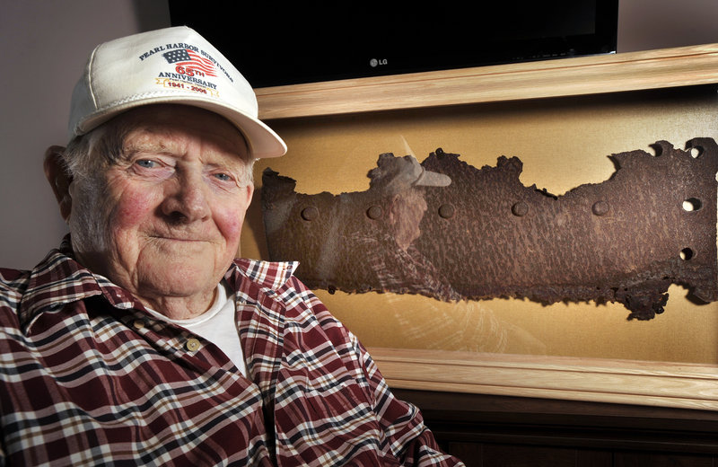Bert Davis, a veteran who lived through attack on Pearl Harbor, with a rusted piece of steel from the USS Arizona, which will be unveiled Friday in Maine on the 71st anniversary of the attack.