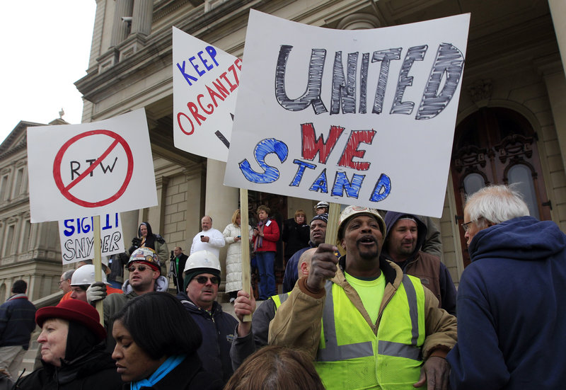 Union workers rally outside the capitol in Lansing, Mich., Thursday as Republicans passed right-to-work legislation.