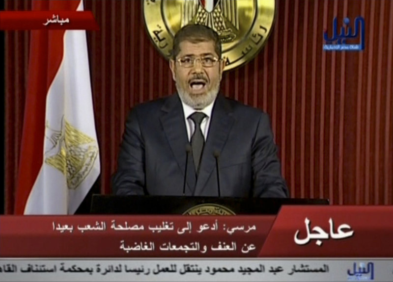 Egyptian President Mohammed Morsi delivers a televised statement in Cairo, Egypt, on Thursday, in which he refused to make any concessions to his opponents.