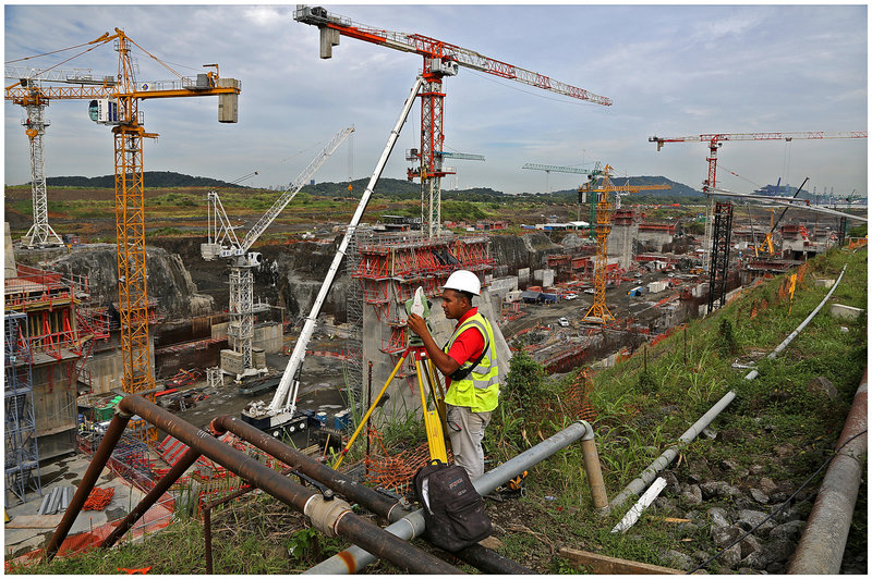 Construction of the bigger locks in the Panama Canal is a round-the-clock operation employing 13,000 people.