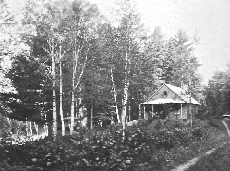 This photograph shows the lodge in 1930. Much of the lodge remains as it was when Louise Dickinson Rich lived there, including her desk and typewriter.