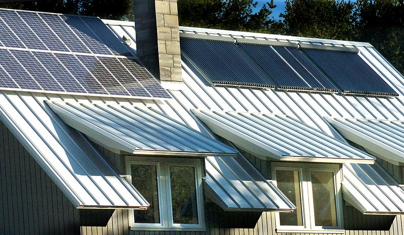 Solar panels and solar hot water panels cover the roof of a Freeport residence. A letter writer who recently installed a grid-tied solar power system says grid disruptions too small for utility equipment to measure can trigger shutdowns in such a system, potentially on a daily basis.