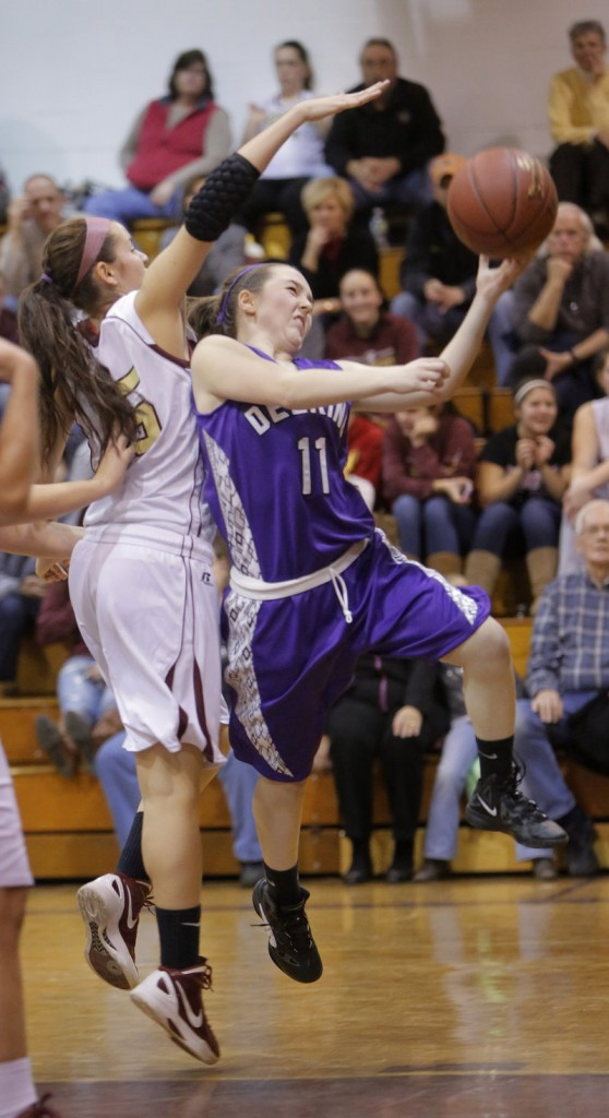 Delaney Coyne of Deering lays the ball up Friday night while eluding a block attempt by Emily Richard of Thornton Academy in their SMAA opener. The shot went in, but moments after the buzzer ended the first quarter. Deering emerged with a 38-35 victory at Saco.