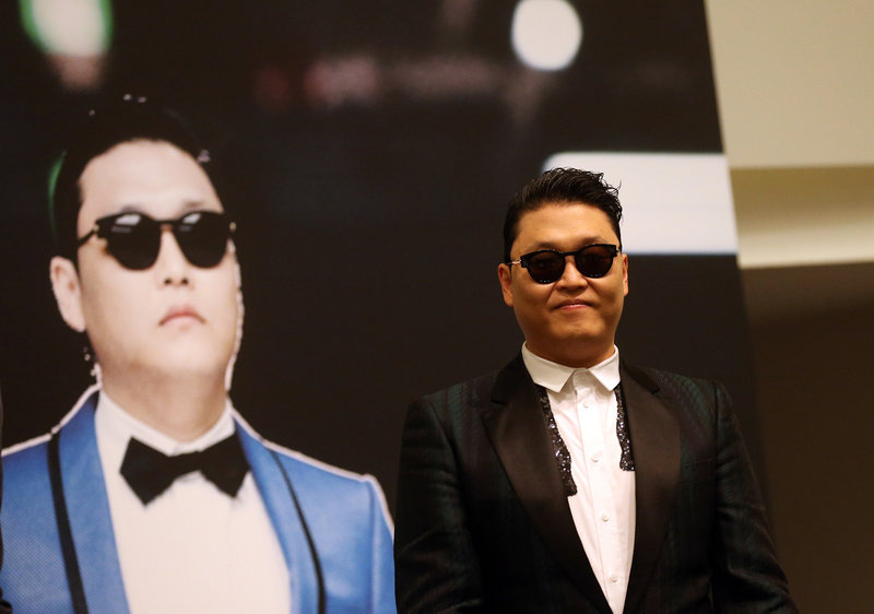 "PSY, who gained popularity from his song ""Gangnam Style,"" talks to the media in Singapore."