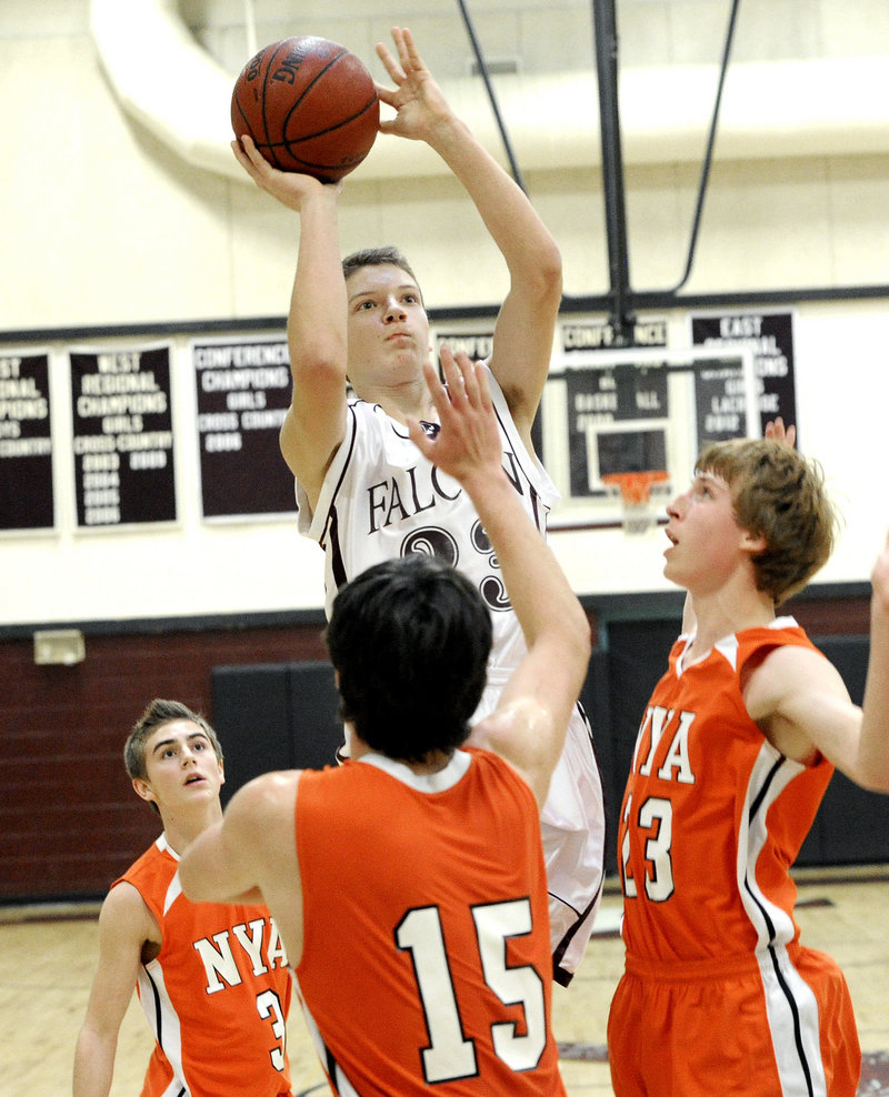 Jack Davenport, who scored 13 points Saturday for Freeport, takes a shot over Burke Paxton, foreground, and Jackson Cohan-Smith, right, of North Yarmouth Academy during Freeport's 51-36 victory.