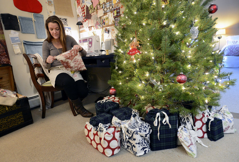 Deborah Ivy makes fabric gift bags in the workshop of her South Portland home. Ivy, an environmental sustainability consultant, grew up in a family that wrapped gifts in fabric bags instead of paper, and she decided to start her business, Tiny Olive, to spread the practice.
