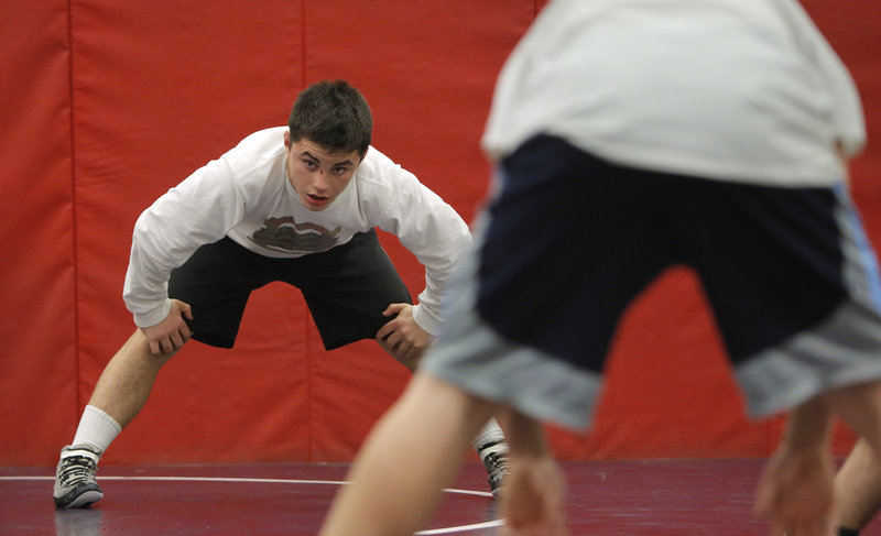 Iain Whitis, a senior at Cheverus who trains with the Deering High team because Cheverus doesn't have its own team, won a Class A state championship last winter in the 120-pound division.