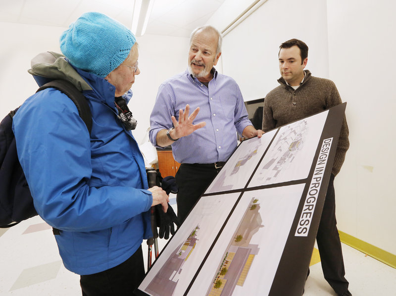 David Lloyd, the design architect for a proposed 400-seat performance venue on Munjoy Hill, talks with resident Bobbi Keppel after a meeting Monday while Frank Bishop – a St. Lawrence Arts Center board member – looks on.